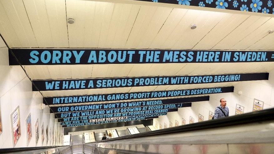 "Banners reading "" Sorry about the mess here in Sweden"", are seen at the subway station Ostermalmstorg in Stockholm, Sweden, on Monday, Aug. 3, 2015.  A poster campaign by the anti-immigrant Sweden Democrats at a subway station in central Stockholm hastirred outrage in the Nordic country. The posters are directed to tourists visiting the Swedish capital and apologize for ""the mess"" in Sweden, saying the country has a problem with ""forced begging"" organized by ""international gangs."" (Bertil Ericson/TT Newsagency via AP)  **SWEDEN OUT **"