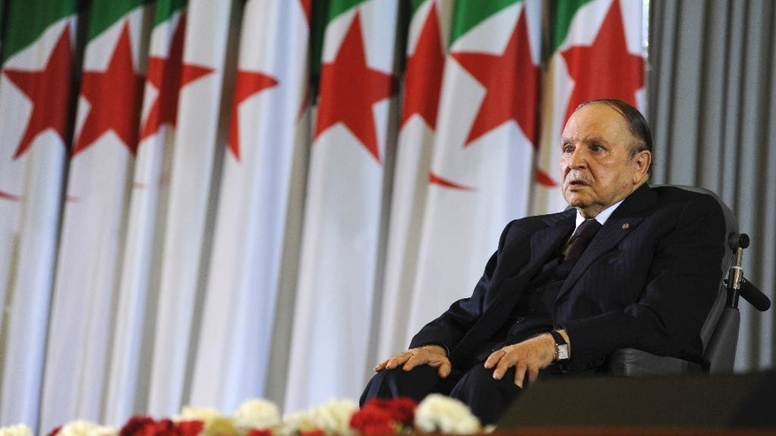 FILE - In this April 28, 2014 file photo, Algerian President Abdelaziz Bouteflika, sitting in a wheelchair, listens after taking the presidential oath in Algiers. Algeria is in the grips of political intrigue, as the president nears death and rumors of coup attempts swirl. Now, the unprecedented firing of three top generals is generating fear that a power struggle within the regime will break into the open - unleashing a new cycle of the bloodshed that plagued the country in the 1990s.  (AP Photo/Sidali Djarboub, File)
