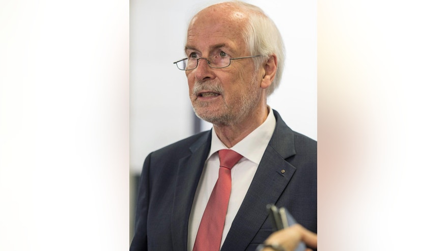 Germany's chief federal prosecutor  Harald Range speaks to journalists  in Karlsruhe, Germany,  Tuesday Aug. 4, 2015.  Range  is accusing the government of interfering in a much-criticized treason investigation against two journalists.   (Ralf Stockhoff/dpa via AP)