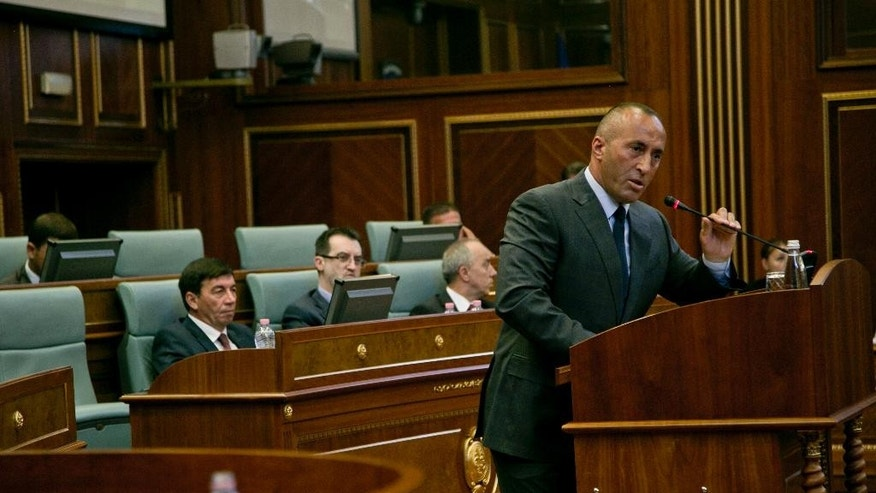Member of the opposition Ramush Haradinaj addresses Kosovo lawmakers during a debate passing constitutional amendments that would allow the establishment of a special court to prosecute its top leaders and former guerrilla fighters for war crimes in capital Pristina on Monday, Aug. 3, 2015. Kosovo's Parliament on Monday approved a constitutional amendment to set up a special court to prosecute former leaders over war crimes, including the killing of hundreds of Serb civilians. (AP Photo/Visar Kryeziu)
