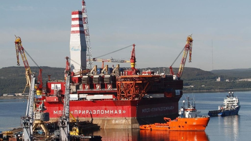 FILE - In this Thursday, Aug. 18, 2011 file photo, the Prirazlomnaya platform is towed from Murmansk to an oilfield in the Pechora Sea, northern Russia. Russia says it has submitted its bid for vast territories in the Arctic to the United Nations. The Foreign Ministry said Tuesday, Aug. 4, 2015, that Russia is claiming 1.2 million square kilometers (over 463,000 square miles) of Artic sea shelf. (AP Photo/Andrei Pronin, file)
