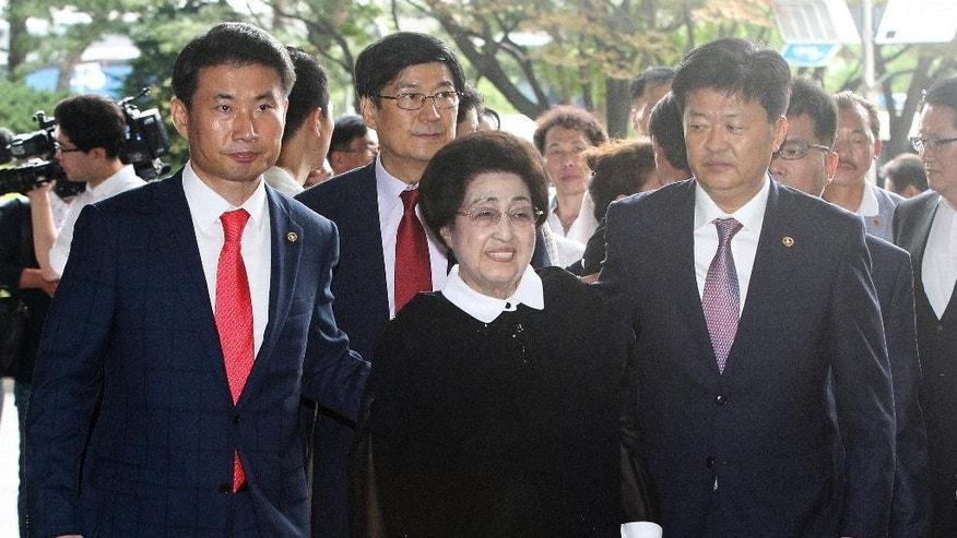 Lee Hee-ho, center, the wife of the late former South Korean President Kim Dae-jung, arrives at Gimpo Airport in Seoul, South Korea, to leave for North Korea Wednesday, Aug. 5, 2015. Lee's planned Aug. 5-8 trip comes amid continuing animosity between the rival Koreas following the recent opening of a U.N. office in Seoul tasked with monitoring what activists call the North's widespread abuse of its citizens' rights.(AP Photo/Ahn Young-joon)