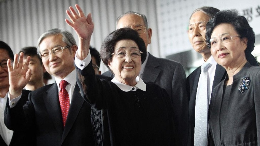 Lee Hee-ho, center, the wife of late former South Korean President Kim Dae-jung, waves as she arrives at Gimpo Airport in Seoul, South Korea, to leave for North Korea Wednesday, Aug. 5, 2015. Lee's planned Aug. 5-8 trip comes amid continuing animosity between the rival Koreas following the recent opening of a U.N. office in Seoul tasked with monitoring what activists call the North's widespread abuse of its citizens' rights.(AP Photo/Ahn Young-joon)