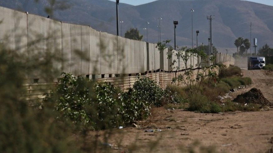 The border wall stands approximately 100 yards from a factory where a drug tunnel was discovered leading into the United States on October 31, 2013 in Tijuana, Mexico.