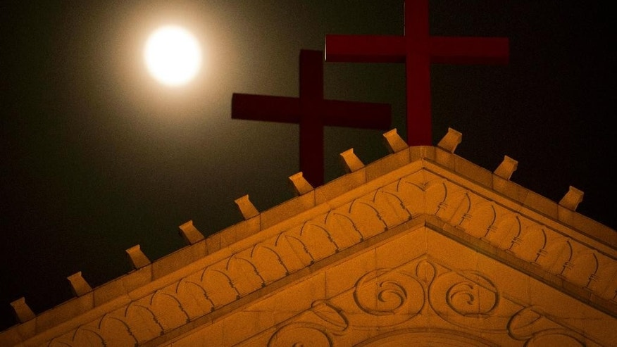 In eastern China's Zhejiang Province church members are keeping a 24-hour vigil to watch for Chinese government workers coming to remove the building's crosses.