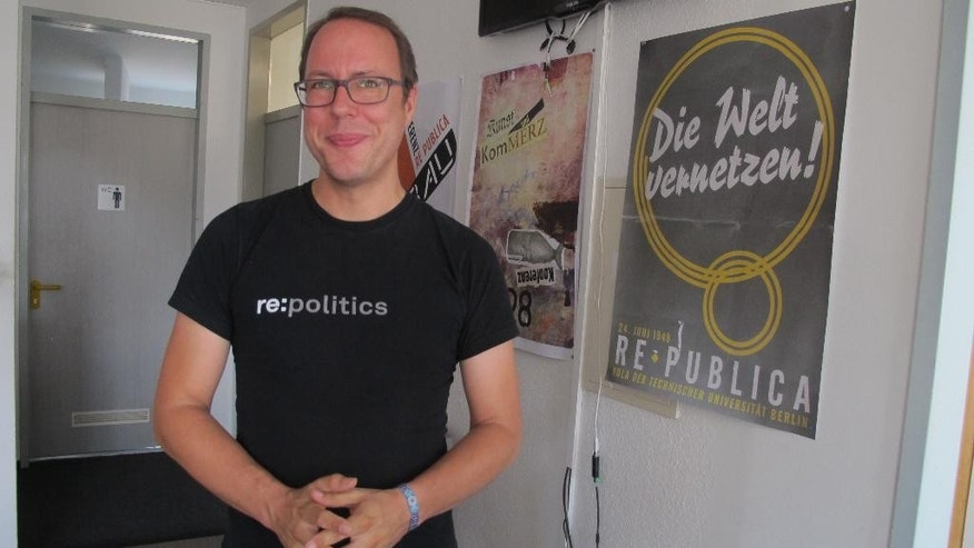 Markus Beckedahl, the editor-in-chief and founder of Netzpolitik,org, speaks during an interview  with The Associated Press at the website's office in Berlin, Germany, on Wednesday, Aug. 5, 2015. The German online magazine thrust into the limelight by a treason probe says it hopes to grow thanks to a surge in donations.  Beckedahl and fellow journalist Andre Meister were informed last week that they are under investigation over articles citing secret plans to expand online surveillance in Germany. The case sparked a political row that led to the firing of Germany's chief federal prosecutor Tuesday. (AP Photo/Frank Jordans)