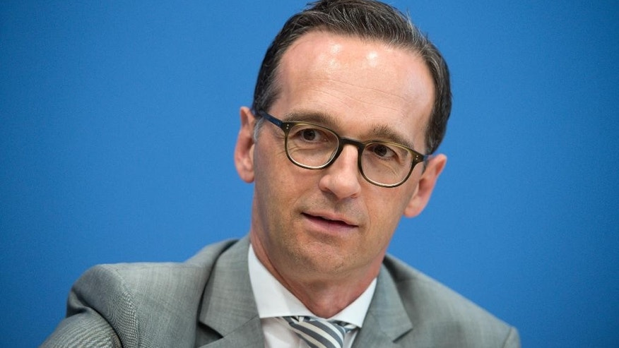 FILE -In this July 14, 2015 file picture German Justice Minister, Heiko Maas , attends a news conference in Berlin.  German Justice Minister Heiko Maas says he will request the dismissal and retirement of chief federal prosecutor Harald Range. Maas said Tuesday  Aug. 4, 2015 he made the decision after consultations with Chancellor Angela Merkel's office. The Justice Ministry has questioned Range's decision to open a treason investigation against two journalists who had reported that Germany's domestic spy agency plans to expand surveillance of online communication.  (  Bernd von Jutrczenka/dpa via AP,file)