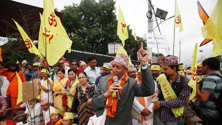 A Hindu priest addresses Hindu activists during a protest near the Nepalese Constituent Assembly Hall during a protest in Kathmandu, Nepal, Wednesday, Aug. 5, 2015. About 500 protesters demanding Nepal be declared a Hindu state in the new constitution clashed with police. No one was injured in scuffles and there were no arrests. (AP Photo/Niranjan Shrestha)