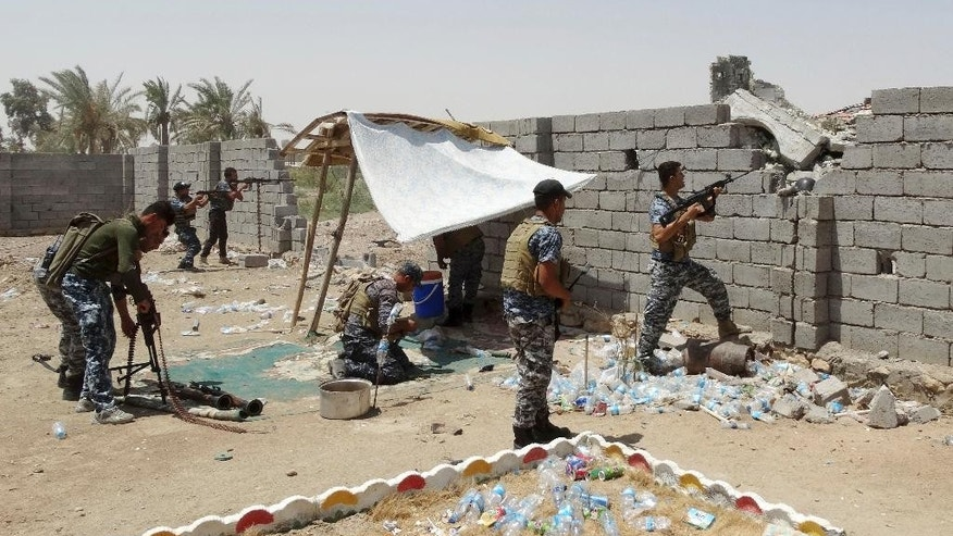 Iraqi security forces backed by Shiite and Sunni pro-government fighters clash with Islamic State group militants at the front line in the eastern suburbs of Ramadi, Anbar province, Iraq, Tuesday, Aug. 4, 2015. (AP Photo)
