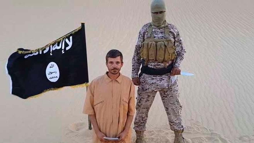 This image purports to show a militant standing next to another man who identifies himself as 30-year-old Tomislav Salopek, kneeling down as he reads a message at an unknown location.