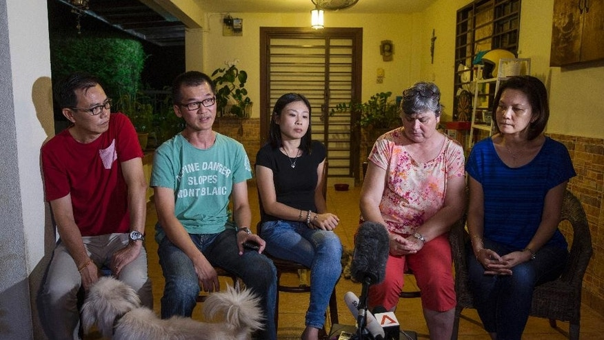 Family members of the missing on Malaysia Airlines Flight 370, from left to right: Choi Loong Chow, 48; Lee Khim Fatt, 45; Elaine Chew, 36; Jacquita Gomes, 53; and Melanie Antonio, 46; speak to journalists in Gomes's house outside Kuala Lumpur, Malaysia, as they wait for further news on Wednesday, Aug. 5, 2015. French and Malaysian experts on Wednesday began examining an airplane wing fragment that could offer the first tangible clue about the fate of Malaysia Airlines Flight 370, which vanished more than a year ago with 239 people aboard. (AP Photo/Joshua Paul)