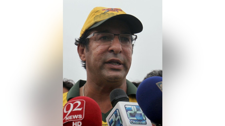 Pakistan's former cricket captain Wasim Akram talks to media regarding a gun attack at the National Stadium in Karachi, Pakistan, Wednesday, Aug. 5, 2015. A gunman opened fire on Pakistan's legendary former cricket captain Wasim Akram in an apparent incident of road-rage in the southern city of Karachi on Wednesday, police said. (AP Photo/Fareed Khan)