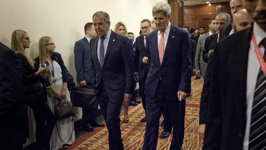 Russian Foreign Minister Sergey Lavrov, left, and U.S. Secretary of State John Kerry walk for a bilateral meeting in Kuala Lumpur, Malaysia, Wednesday, Aug. 5, 2015. (Brendan Smialowski/Pool Photo via AP)