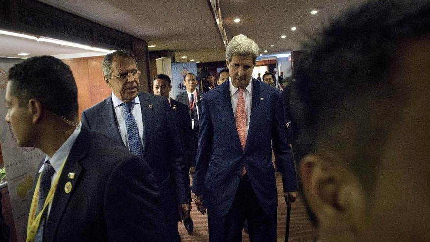 Russian Foreign Minister Sergey Lavrov, left, and U.S. Secretary of State John Kerry walks for a bilateral meeting in Kuala Lumpur, Malaysia, Wednesday, Aug. 5, 2015. (Brendan Smialowski/Pool Photo via AP)