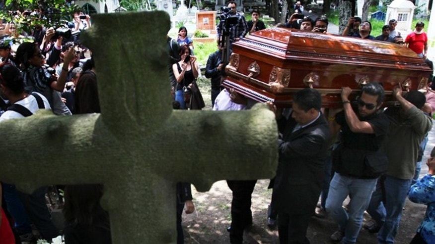 Men carry the casket of murdered photojournalist Rubén Espinosa during his funeral service in Mexico City, Monday, Aug. 3, 2015. With an investigation barely underway, Mexican journalist protection groups are already expressing fears that authorities won't consider Espinosa's brutal killing as being related to his work - even though he fled the state he covered fearing for his safety. Espinosa, 31, worked for the investigative magazine Proceso and other media in Veracruz state. (AP Photo/Marco Ugarte)