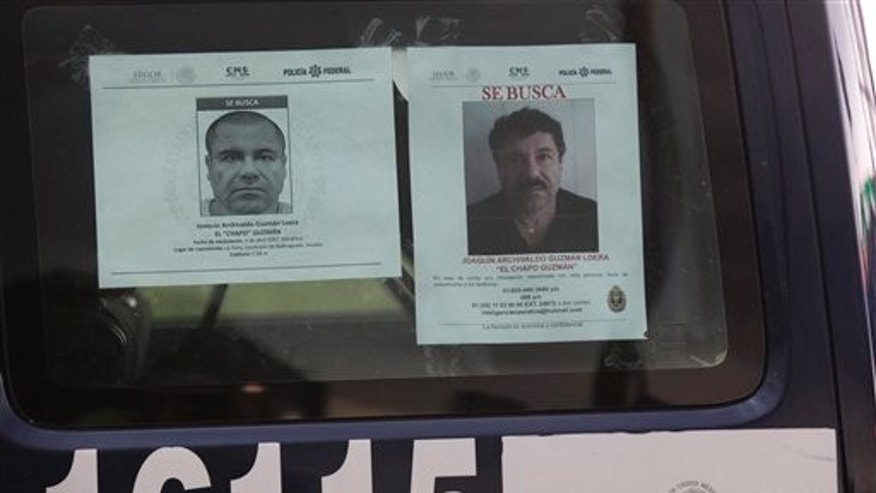 "A Mexican Federal Police vehicles displays a wanted notice and a reward notice for information leading to the capture of drug lord Joaquin ""El Chapo"" Guzman, on a highway west of Mexico City, Thursday, July 16, 2015. The Mexican government is offering a reward of $3.8 million (60 million pesos) for Guzman's recapture, who made his escape Saturday from the Altiplano maximum security prison via an underground tunnel. (AP Photo/Marco Ugarte)"