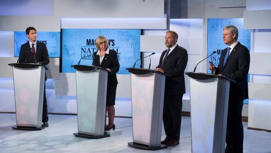 Leaders of Canada's four political parties, Liberal leader Justin Trudeau, left to right, Green Party leader Elizabeth May, New Democratic Party leader Thomas Mulcair and Conservative leader, Prime Minister Stephen Harper exchange views during the first leaders debate Thursday, Aug. 6, 2015, in Toronto. (Frank Gunn/The Canadian Press via AP) MANDATORY CREDIT
