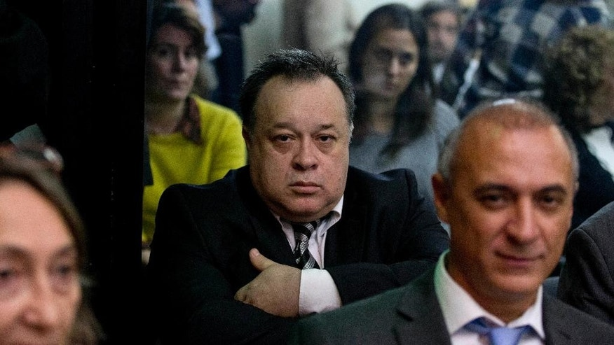 Carlos Telleldin attends a trial where he and others are accused of derailing an investigation into the 1994 bombing of the Argentina Jewish Center in Buenos Aires, Argentina, Thursday, Aug. 6, 2015. A central part of the cover-up charges involves a 1996 payment of $400,000 to Telleldin, at the time the only person detained in connection with the bombing. Telleldin was a mechanic who owned the truck that carried the explosives, days before the attack. No one has been convicted in the terrorist attack that killed 85 people. (AP Photo/Natacha Pisarenko)