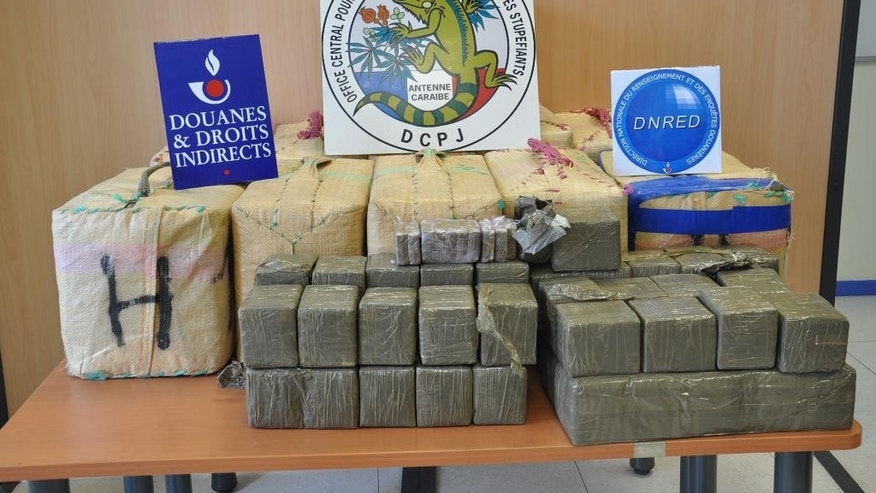 This undated photo provided by Martinique's National Anti-Drug Office, and taken by the French Customs office in Martinique, shows seized packages of hash in Fort-de-France. Officials said Thursday, Aug. 6, 2015 that customs agents on the French territory of Martinique made a record seizure of hash at the island's Caribbean port. Officials put the value of the 404 kilograms (891 pounds) of hash at about $2.6 million. It was more than all hash seizures combined from 2012 to 2014 in Martinique and two other French overseas territories, the majority involving small amounts found on couriers at airports. (Martinique's National Anti-Drug Office via AP)
