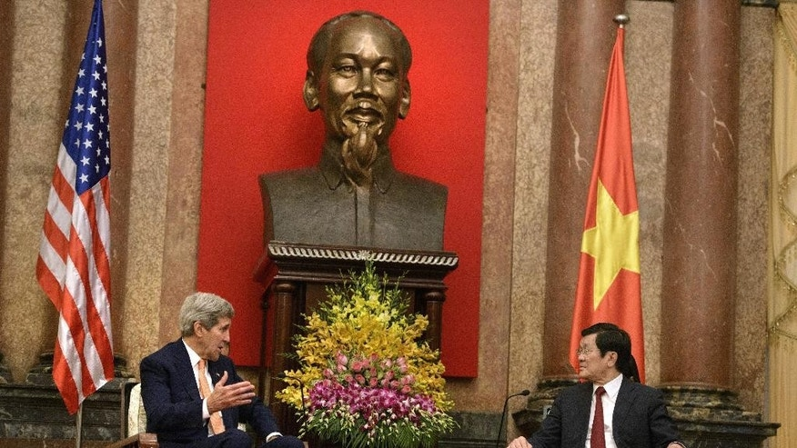 U.S. Secretary of State John Kerry, left, and Vietnamese President Truong Tan Sang talks during a meeting at the Presidential Palace in Hanoi, Vietnam, Friday, Aug. 7, 2015. (Brendan Smialowski via AP)