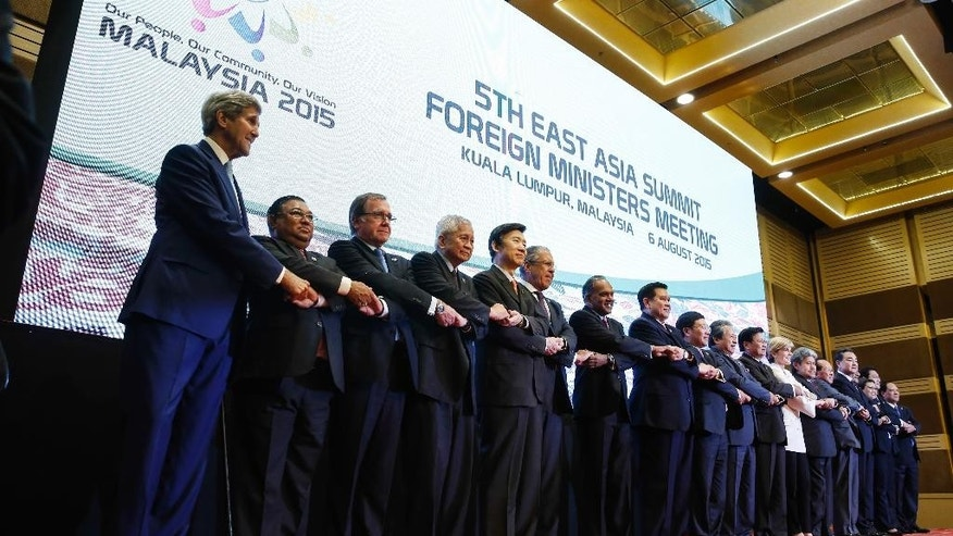 From left to right, U.S. Secretary of State John Kerry, Myanmar's Foreign Minister Wunna Maung Lwin, New Zealand's Foreign Minister Murray McCully, Philippines Secretary of Foreign Affairs Albert del Rosario, South Korea's Foreign Minister Yun Byung-se, Russia's Foreign Minister Sergey Lavrov, Singapore's Foreign Minister K. Shanmugam, Thailand's Foreign Minister Tanasak Patimapragorn, Vietnam's Foreign Minister Pham Binh Minh, Malaysia's Foreign Minister Anifah Aman, Laos's Foreign Minister Thongloun Sisoulith, Australia's Foreign Minister Julie Bishop, Brunei's Foreign Minister Mohamed Bolkiah, Cambodia's Foreign Minister Hor Namhong, China's Foreign Minister Wang Yi, India's Foreign Minister Vijay Kumar Singh, Indonesia's Foreign Minister Retno Marsudi, Japan's Foreign Minister Fumio Kishida and ASEAN's Secretary General Le Luong Minh pose for a photograph before the East Asia Summit Foreign Ministers' Meeting in Kuala Lumpur, Malaysia Thursday, Aug. 6, 2015. (AP Photo/Joshua Paul)