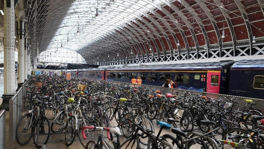 Thousands of bicycles are locked in a bike rack at Paddington Station in London, Thursday, Aug. 6, 2015. Commuters are having to find alternative methods of travel Thursday as the London tubes are not running due to a strike. London's mayor has ruled out offering more money to resolve a London Underground labor set to shut down services for the second time this summer. (AP Photo/Kirsty Wigglesworth)