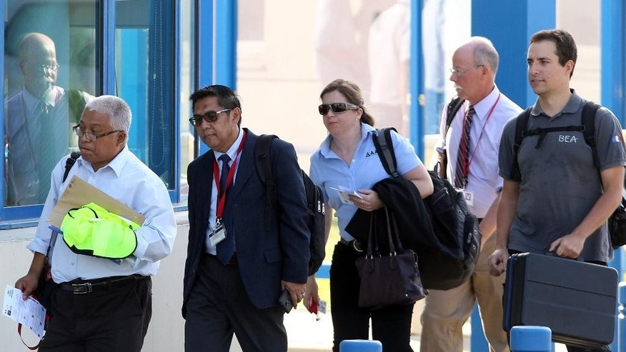 Malaysia's Department of Civil Aviation Director General Azharuddin Abdul Rahman, centre left, walks with unidentified personnel leave the Direction Generale de l'Armement (DGA) facilities in Balma, near Toulouse, south-western France, Wednesday, Aug. 5, 2015. French and Malaysian experts on Wednesday began examining an airplane wing fragment that could offer the first tangible clue about the fate of Malaysia Airlines Flight 370, which vanished more than a year ago with 239 people aboard. (AP Photo/Bob Edme)
