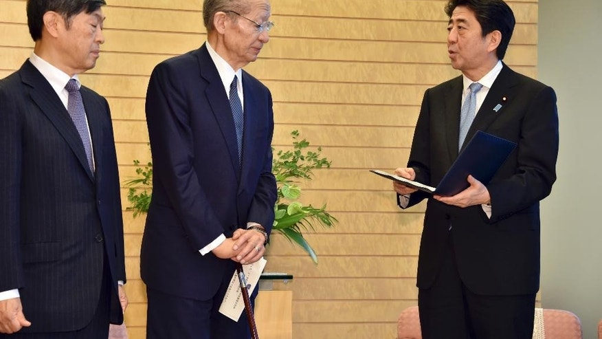 Japanese Prime Minister Shinzo Abe, right, speaks after receiving a 38-page report from Taizo Nishimuro, center, chairman of the Japanese government's advisory panel on the history of the 20th century and on Japan's role and the world order in the 21st century, and Shinichi Kitaoka, deputy of the panel, at Abe's office in Tokyo Thursday, Aug. 6, 2015. The government panel commissioned by Abe to review the country's recent history has praised Japan's postwar economic growth and commitment to pacifism but also cites lack of reconciliation with China and South Korea. The report released Thursday did not specify what Abe should say in his statement marking the 70th anniversary of the end of World War II later this month, or whether he should use the same language to convey the apology from 1995 by then-Prime Minister Tomiichi Murayama. However, the report urged sensitivity for the feelings of the victims of Japan's wartime actions. (Yoshikazu Tsuno/Pool Photo via AP)