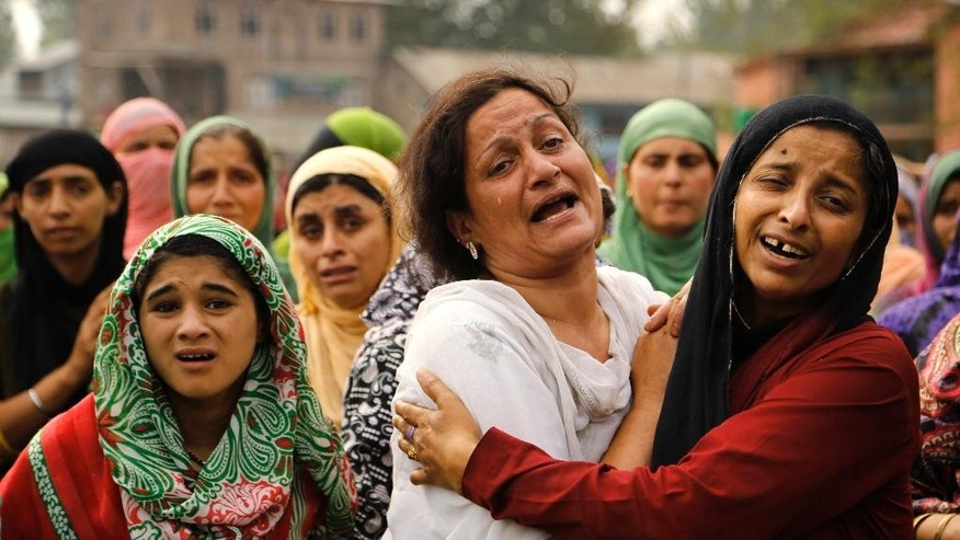 Unidentified women grieve during the funeral of Talib Shah, a suspected local rebel commander of Lashkar-eTaiba (LeT),  at Pulwama, 35 kilometers (22 miles) south of Srinagar, Indian-controlled Kashmir, Friday, Aug. 7, 2015. Shah, was killed in a gun battle against Indian security forces. (AP Photo/Mukhtar Khan)