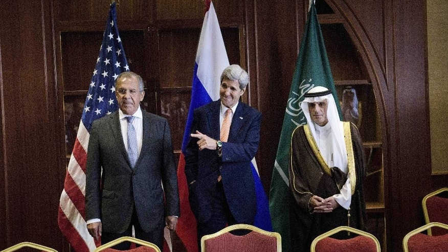 FILE - In this Monday Aug. 3, 2015 file photo, Russia's Foreign Minister Sergey Lavrov, from left, U.S. Secretary of State John Kerry and Saudi Foreign Minister Adel al-Jubeir stand together before a trilateral meeting in Doha, Qatar. The international community's nuclear deal with Iran was widely expected by affect other Middle East issues, and that may already be happening with Syria: a series of recent diplomatic maneuvers suggests a growing willingness by Gulf players to engage with the Iranian-backed government of Syrian President Bashar Assad. (Brendan Smialowski/Pool photo via AP, File)