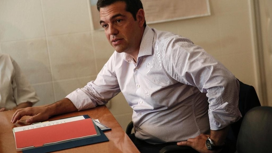 Greece's Prime minister Alexis Tsipras presides over a ministerial meeting regarding the migration crisis in Athens, Friday, Aug. 7, 2015. The European Union appealed Friday to its member countries to live up to pledges to provide planes and other assets so that its border agency can cope with a migrant influx into Greece and Hungary. (AP Photo/Yorgos Karahalis)