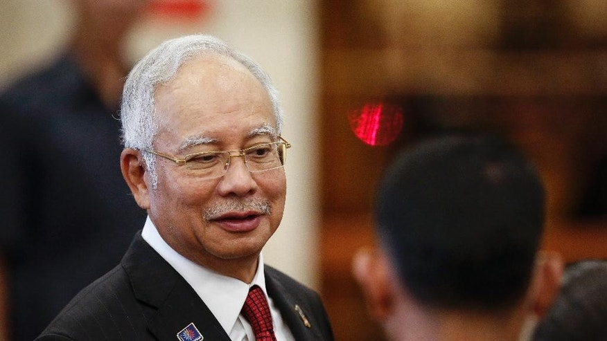Malaysian Prime Minister Najib Razak looks on during the visit of Vietnamese Prime Minister Nguyen Tan Dung in Putrajaya, Malaysia on Friday, Aug. 7, 2015. Najib called a press conference at 1 a.m. Thursday in Kuala Lumpur to say that a wing fragment found on an Indian Ocean island had been definitively linked to Malaysia Airlines Flight 370. That announcement came an hour ahead of one from French investigators that differed in a significant way: They confirmed the part was from a 777, but did not have proof that it was from Flight 370 .(AP Photo/Joshua Paul)