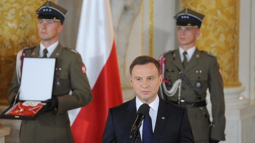 Poland's new President Andrzej Duda speaks during his inauguration ceremony at the Royal Castle in Warsaw, Poland, Thursday, Aug. 6, 2015. (AP Photo/Alik Keplicz)