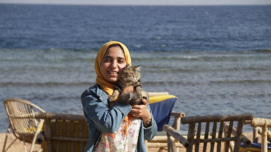 "In this photo provided by el-Taweel family on Friday, Aug. 7, 2015, jailed Egyptian photographer and activist Esraa el-Taweel poses for a photo in Egypt's Dahab beach in 2015. Doaa el-Taweel, the sister of Esraa, jailed in Egypt for alleged ties to the outlawed Muslim Brotherhood, urged the Islamic State group on Friday not to kill a Croatian hostage they are holding. The extremist group had earlier said it would do so in the coming hours if the Egyptian government did not release jailed ""Muslim women."" (Courtesy of el-Taweel family via AP)"