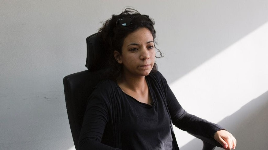 "Doaa el-Taweel, sister of jailed Egyptian photographer and activist Esraa el-Taweel, poses for a photo during an interview with The Associated Press in Cairo, Egypt, Friday, Aug. 7, 2015. The sister of Esraa, jailed in Egypt for alleged ties to the outlawed Muslim Brotherhood, urged the Islamic State group on Friday not to kill a Croatian hostage they are holding. The extremist group had earlier said it would do so in the coming hours if the Egyptian government did not release jailed ""Muslim women"" (AP Photo/Hiro Komae)"