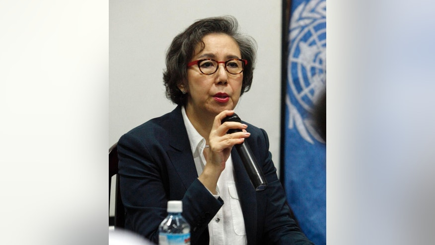 Yanghee Lee, United Nation's Human Rights Special Envoy to Myanmar, talks to journalists during a press conference at the UN office in Yangon, Myanmar, Friday, Aug 7, 2015. (AP Photo/Khin Maung Win)