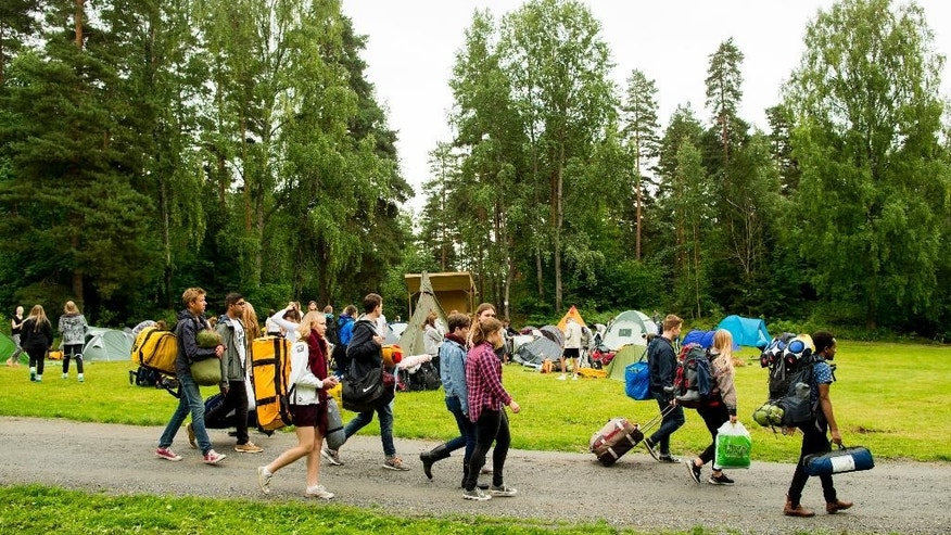 Young people arrive to camp at Utoya Island in Norway, Thursday, Aug. 6, 2015. Four years ago a right-wing extremist gunned down 69 people, shattering the tranquility on the idyllic Norwegian island of Utoya after killing eight in a bomb blast at government buildings in the center of the capital Oslo. This week, a flood of newcomers will be arriving on the island as the Labor Party's youth camp opens for the first time since the massacre on July 22, 2011. (Vegard Wivestad Grott/NTB Scanpix via AP)     NORWAY OUT