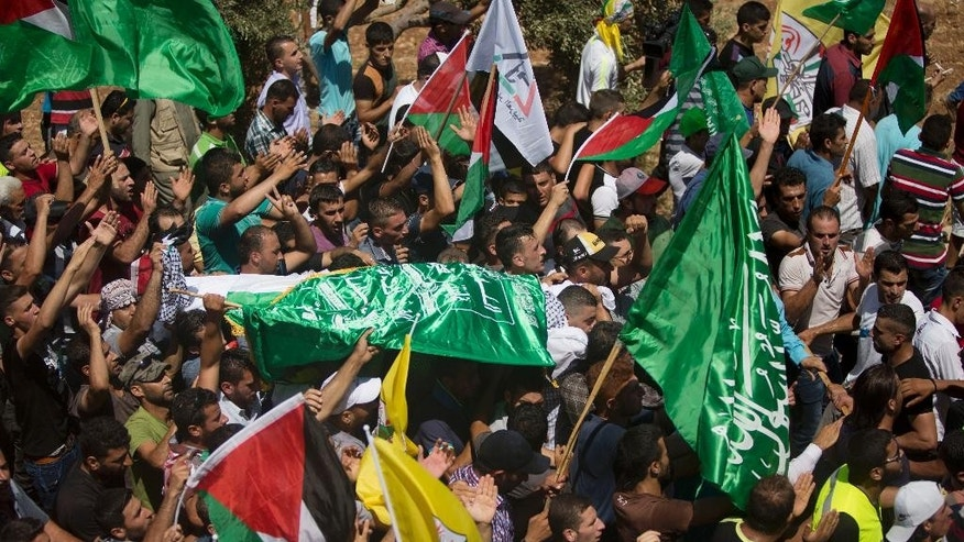 Palestinians carry the body of Saed Dawabsheh, 32, during his funeral procession in the West Bank village of Duma near Nablus on Saturday, Aug. 8, 2015. The father of a Palestinian toddler killed in a July 31 firebomb attack blamed on Jewish extremists has died of wounds sustained in the same incident, his family said Saturday. His 18-month-old toddler perished in the flames, while his 4-year-old brother and parents were seriously hurt. (AP Photo/Majdi Mohammed)