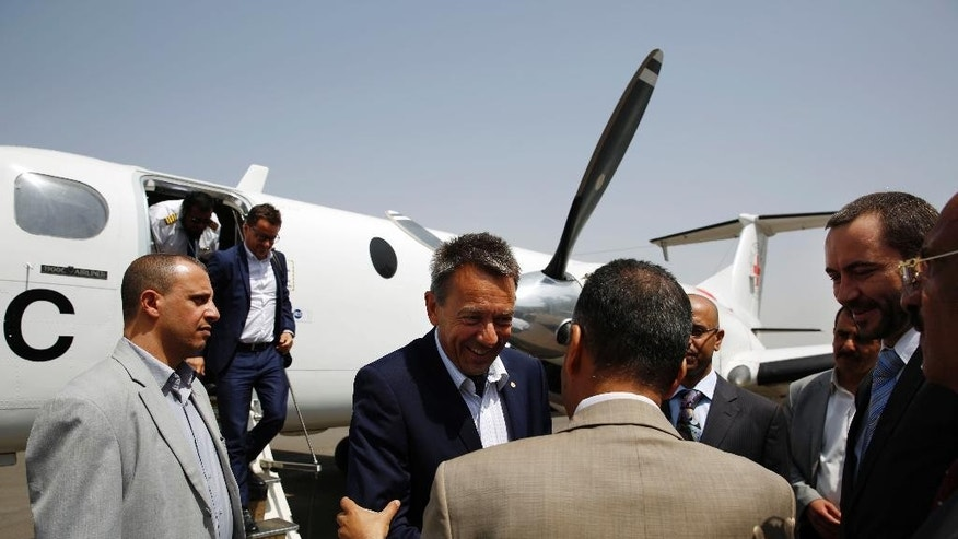 Peter Maurer, the president of the International Committee of the Red Cross, center, arrives at the international airport in Sanaa, Yemen, Saturday, Aug. 8, 2015. (AP Photo/Hani Mohammed)