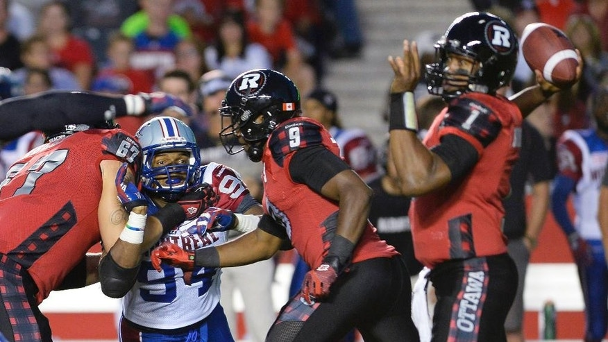 Montreal Alouettes' Michael Sam (94) tries to disrupt the Ottawa Redblacks' offense during the first half of a Canadian Football League game in Ottawa, Ontario, on Friday, Aug. 7, 2015. (Justin Tang/The Canadian Press via AP)
