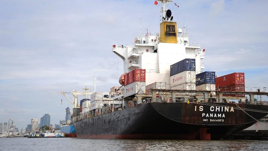 In this Thursday, Aug. 6, 2015, photo, a cargo ship is parked near Klong Toey Port in Bangkok, Thailand.  The Association of Southeast Asian Nations, which on Saturday marks 48 years since its establishment, aims to establish an economic community known as the AEC by the end of this year. Proponents say the ultimate goal is to allow free trade, investment and movement of workers between the 10 nations that make up the grouping. But progress toward a borderless economy in a region that brings together democracies and dictatorships along with rich and poor nations is likely to be slow. (AP Photo/Penny Yi Wang)