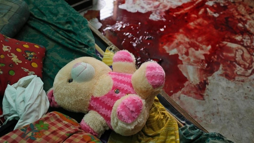 A soft toy lies on a bed near blood stains on the floor where blogger Niloy Chowdhury, 40, was hacked to death at his house in Dhaka, Bangladesh, Friday, Aug. 7, 2015. Assailants believed to be Islamist militants entered an apartment building posing as potential tenants and killed the secular blogger in Bangladesh's capital on Friday, in the fourth such deadly attack this year, police said. (AP Photo/A.M. Ahad)