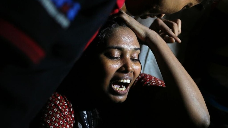 Ashamoni, wife of blogger Niloy Chowdhury, cries at her house in Dhaka, Bangladesh, Friday, Aug. 7, 2015. Assailants believed to be Islamist militants entered an apartment building posing as potential tenants and killed the secular blogger in Bangladesh's capital on Friday, in the fourth such deadly attack this year, police said. The killing is the fourth of a secular blogger since February. (AP Photo/A.M. Ahad)