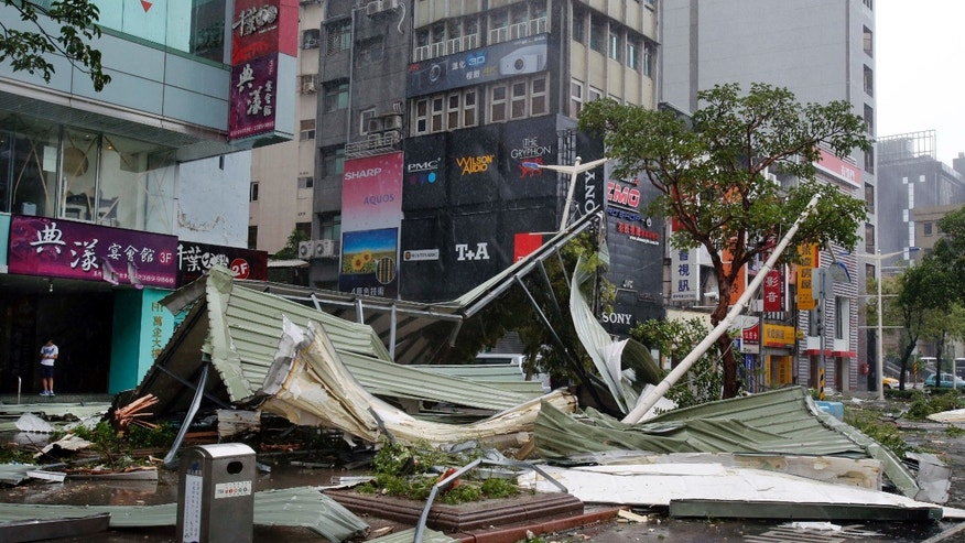 Aug. 8, 2015: A street corner is filled with a mangled rooftop brought down by strong winds from Typhoon Soudelor in Taipei, Taiwan.