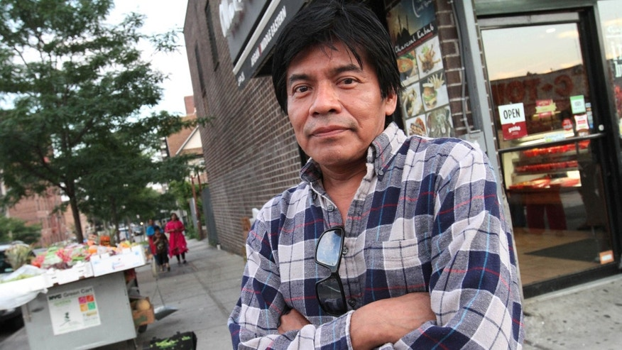 Manuel de Jesus Santiago Lopez, 50, poses for photograph in the Queens borough of New York, Monday Aug. 3, 2015. As a campaign to raise the minimum wage as high as $15 has rolled to victory in such places as Seattle, Los Angeles and New York, it has bumped up against a harsh reality: Plenty of scofflaw businesses donât pay the legal minimum now and probably wonât pay the new, higher wages either. Santiago said when he had a wage dispute a few years ago at a deli that was paying him $300 per week, for 78 hours of work, the boss threatened to call immigration officials and have him deported.  (AP/Tina Fineberg)