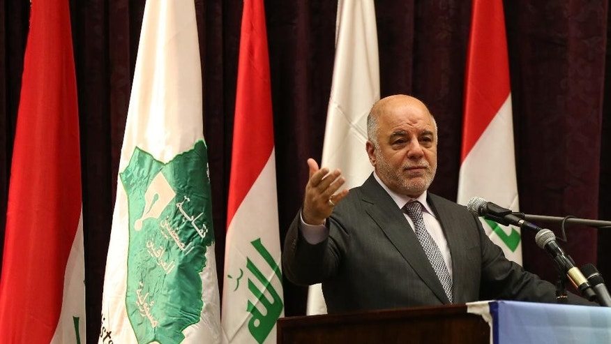 FILE - In this Saturday, June 27, 2015 file photo, Iraqi Prime Minister Haider al-Abadi announces the arrest of Abdel Baqi al-Sadun, a senior official in the disbanded Baath Party, during a press conference in Baghdad, Iraq. Iraq's cabinet approved a wide-ranging reform plan on Sunday that would abolish the three vice presidential posts as well as the office of deputy prime minister in order to slash spending and improve the government's performance in the face of mass protests.  (AP Photo/Karim Kadim, File)
