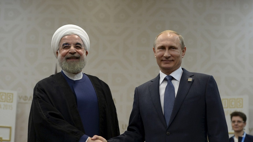 July 9, 2015 - FILE photo of Russian President Vladimir Putin shaking hands with Iran's President Hassan Rouhani during their meeting in Ufa, Russia. 2 Russian warships have docked in northern Iran for naval training exercises, Iranian media reported.