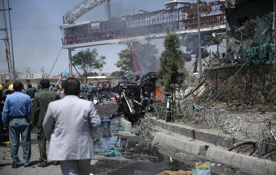 Aug. 10, 2015 - Afghan security forces inspect the site of an attack at the main gate of International Hamed Karzai Airport in Kabul, Afghanistan. The bombing at a busy roundabout near the airport killed 5 people.