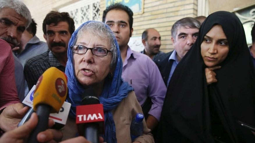 Mary Rezaian, mother of detained Washington Post correspondent Jason Rezaian, speaks with media as she leaves a Revolutionary Court building in Tehran, Iran, Monday, Aug. 10, 2015. The final hearing of Rezaian detained in Iran more than a year ago and charged with espionage ended on Monday, Aug. 10, 2015 with a verdict expected in the coming days in a trial that has been condemned by the newspaper and press freedom groups. (AP Photo/Vahid Salemi)