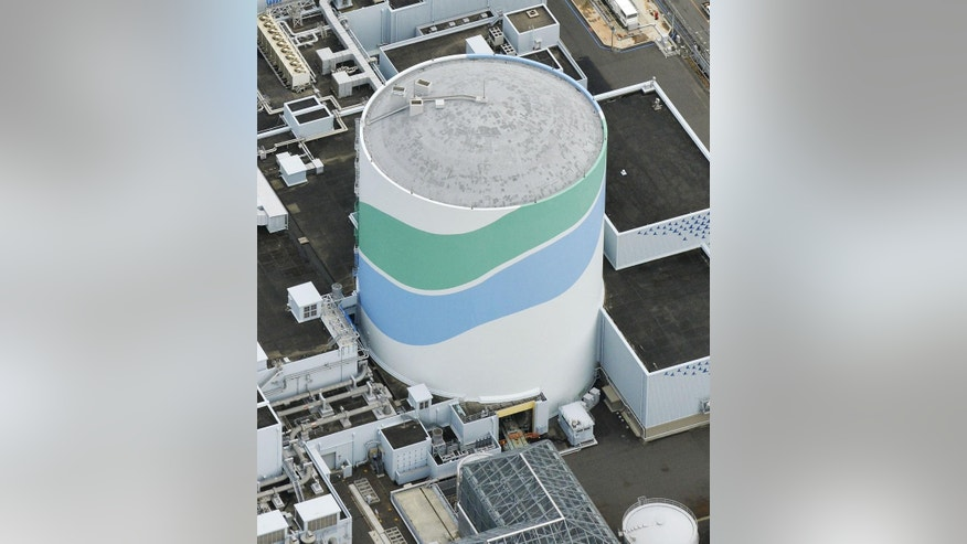 This aerial photo taken on July 7, 2015, shows reactor of No. 1 at the Sendai Nuclear Power Station in Satsumasendai, Kagoshima prefecture, southern Japan. Kyushu Electric Power Co. said Tuesday, Aug. 11, 2015,  it had restarted the No. 1 reactor at its Sendai nuclear plant as planned. The restart marks Japan's return to nuclear energy four-and-half-years after the 2011 meltdowns at the Fukushima Dai-ichi nuclear power plant in northeastern Japan following an earthquake and tsunami (Hiroko Harima/Kyodo News via AP) JAPAN OUT, MANDATORY CREDIT